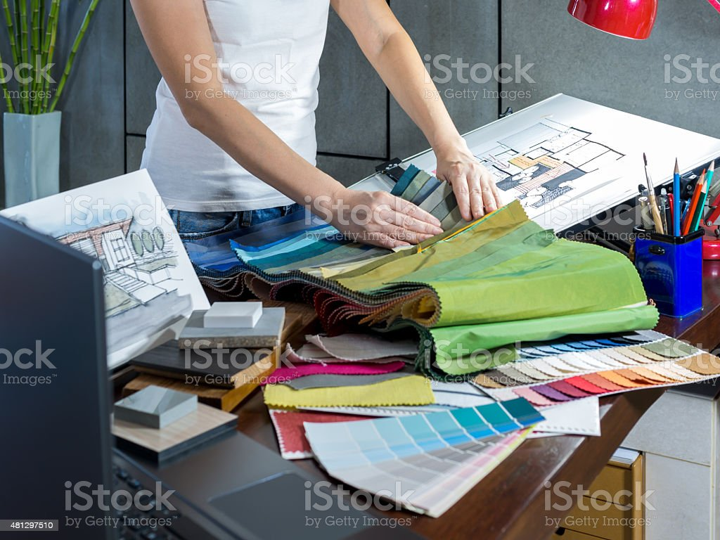 Designer working with illustration sketch, material sample in Architects office stock photo