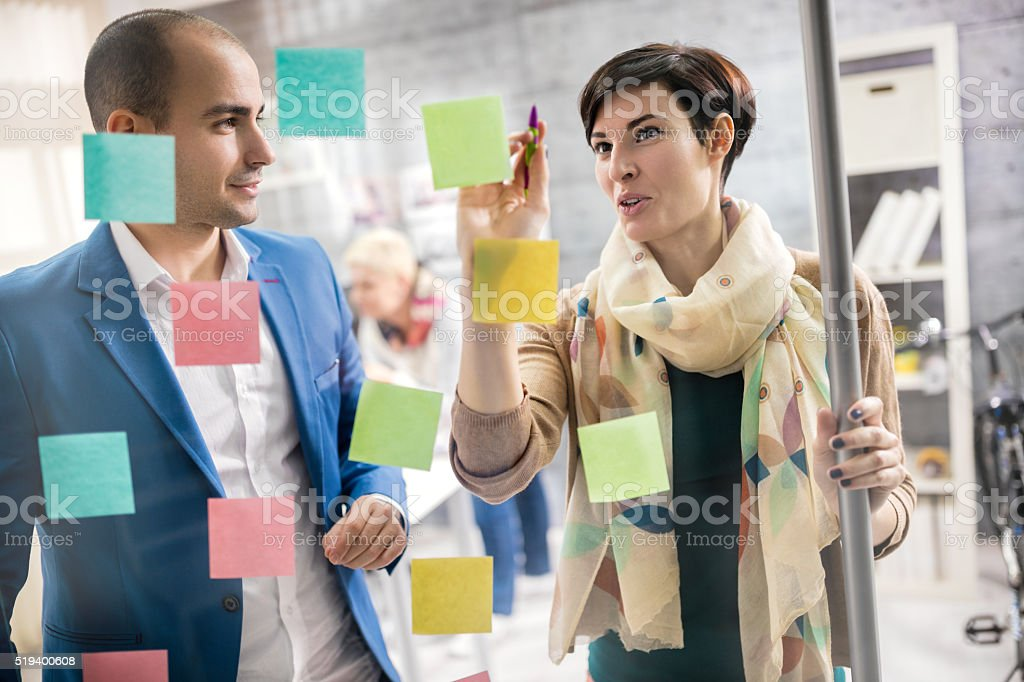 Designers discus about artistic plan at design studio stock photo