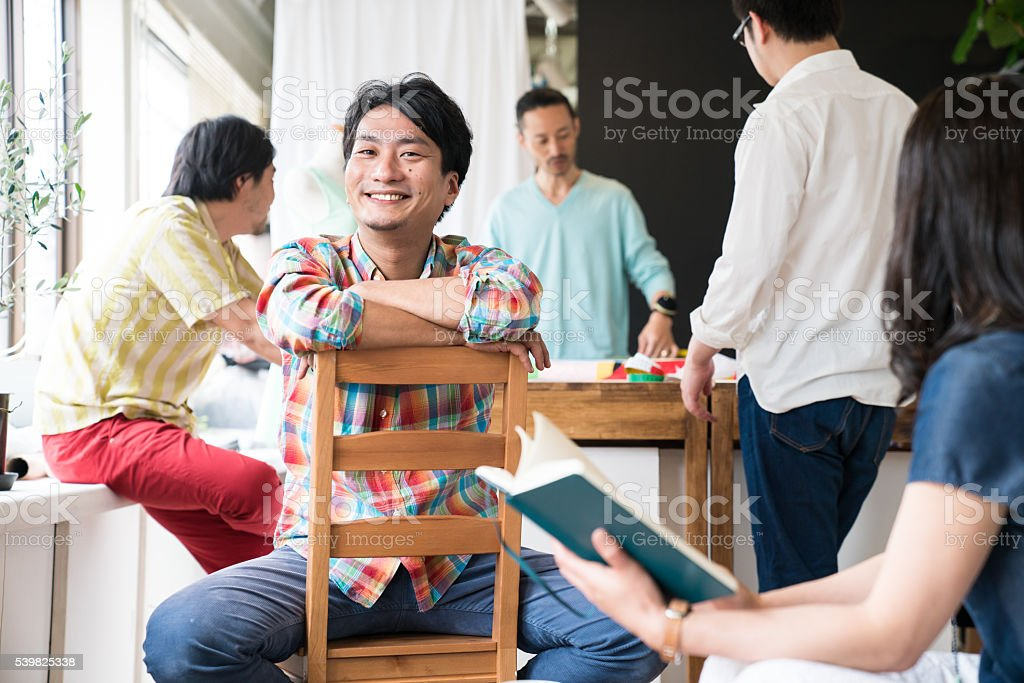 Designers discussing in a creative studio environment stock photo