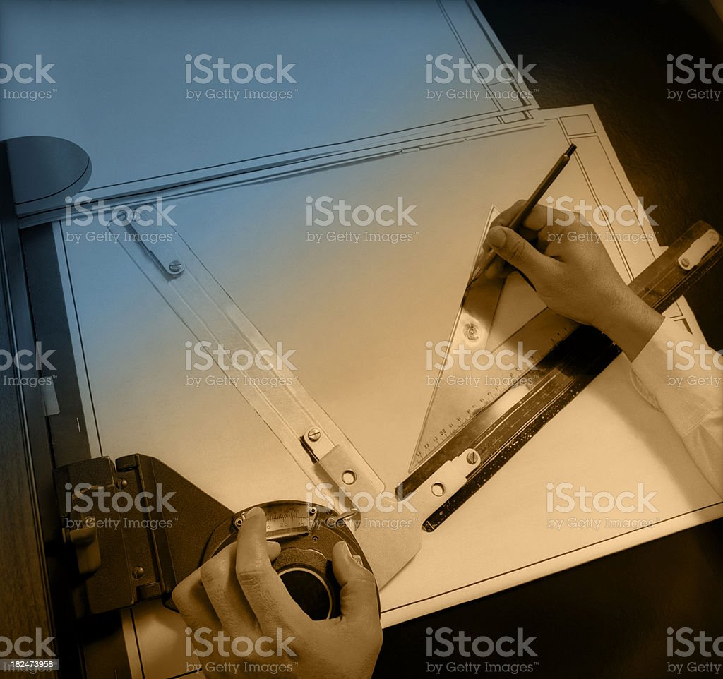 Designer's Hands with Blueprints royalty-free stock photo
