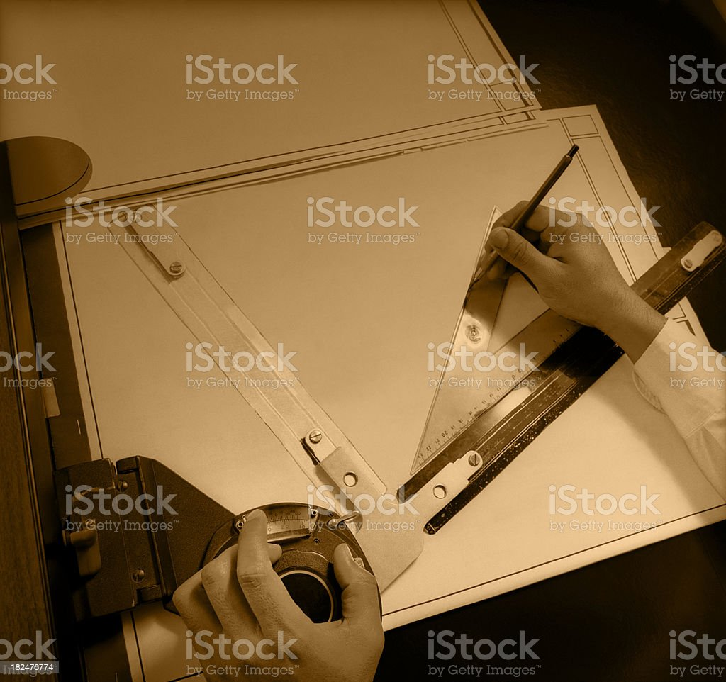 Designer's Hands with Blueprints Sepia Toned royalty-free stock photo