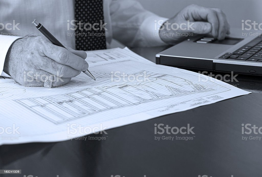 Designer's hands with laptop and blue tint royalty-free stock photo