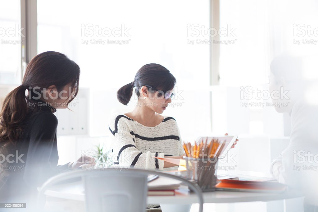 Designers have a planning meeting in modern office stock photo