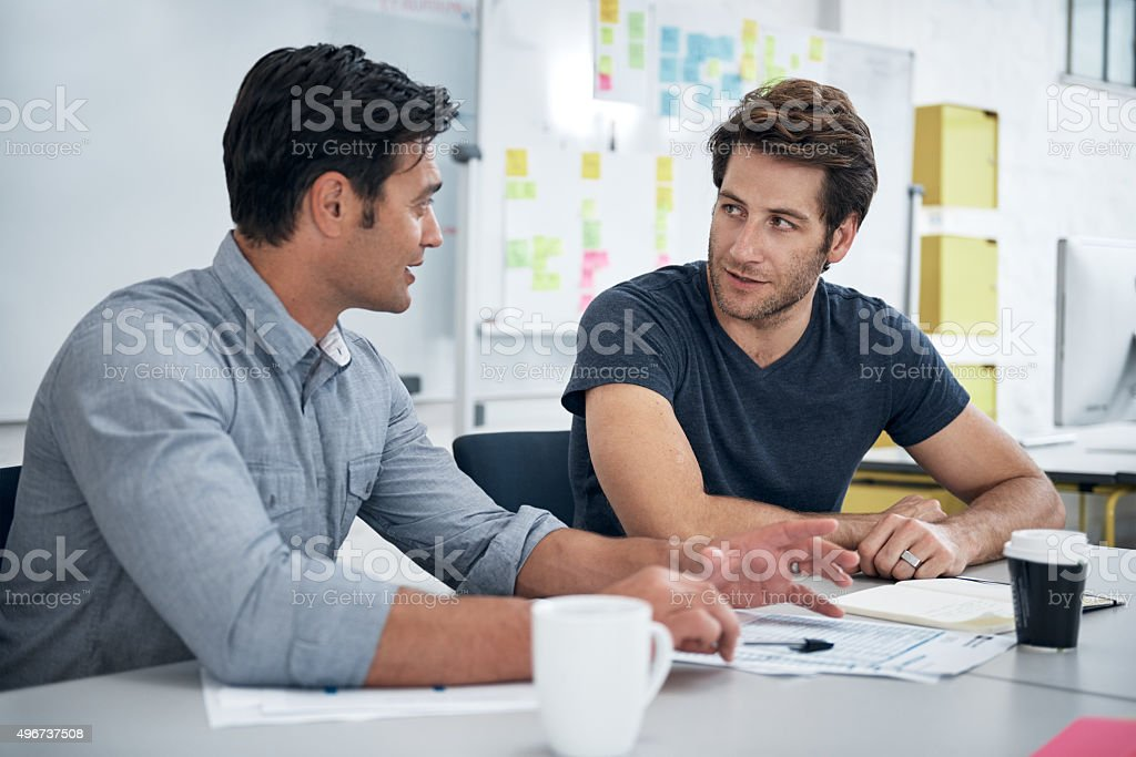 Designers in discussion stock photo