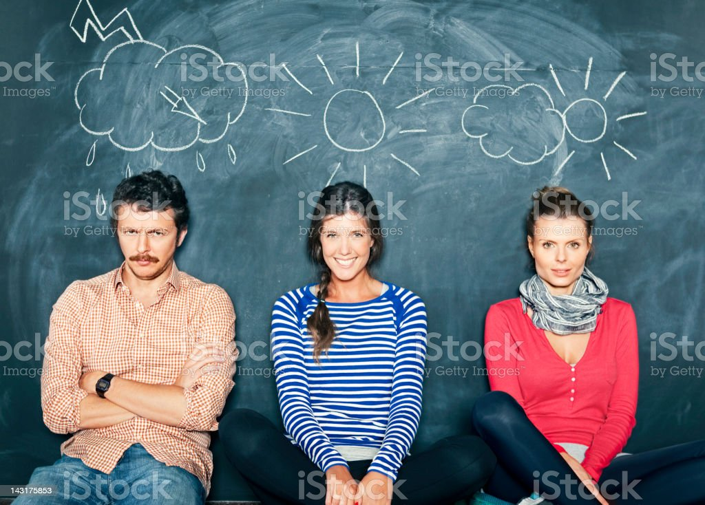 Designers in front of a blackboard stock photo