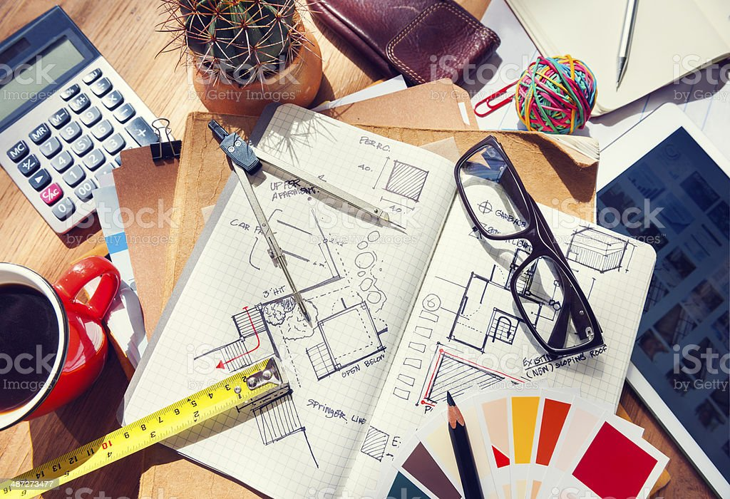 Designer's table with tools and sketches stock photo