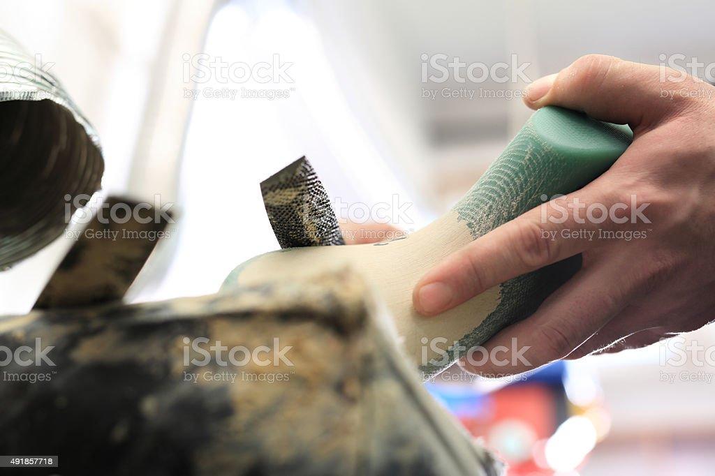 Designing shoes, occupation shoemaker stock photo