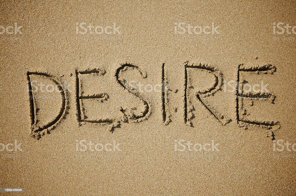 Desire Single Word Handwritten Message in Thick Brown Sand royalty-free stock photo