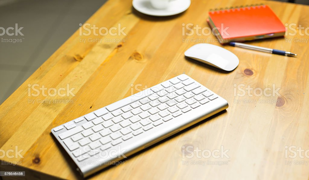 Desk accessories desktop, keyboard, computer mouse on wooden oak table stock photo