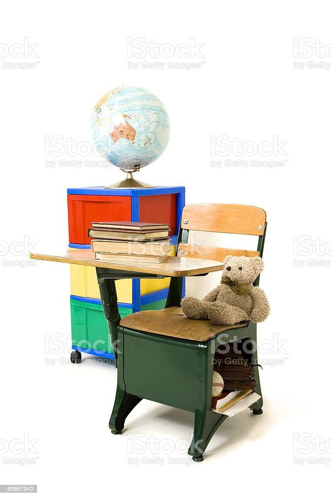 Desk, books, storage cabinet and globe royalty-free stock photo