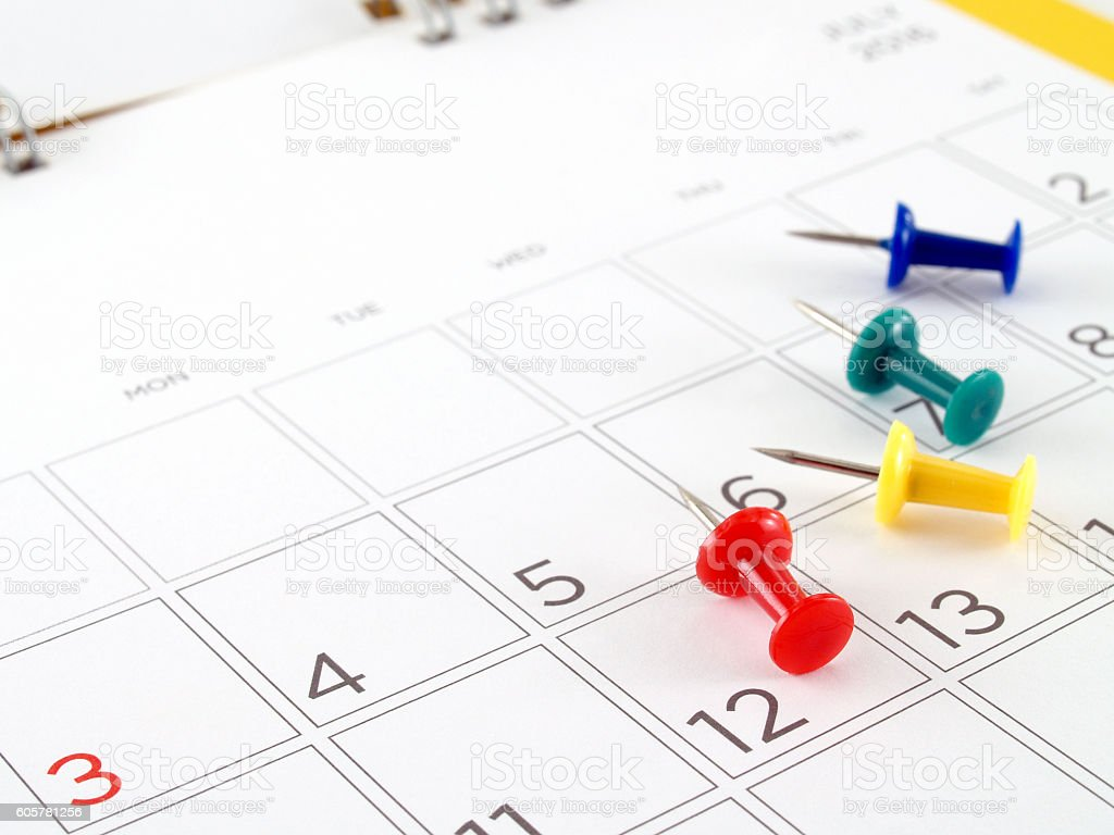 desk calendar in July 2016 and colorful thumbtack stock photo