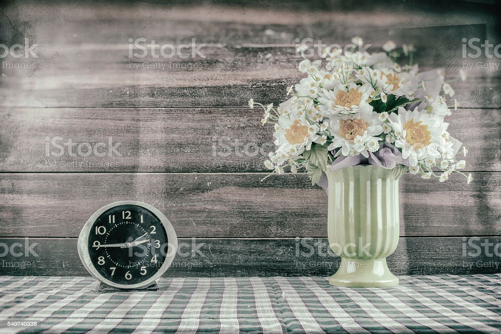 Desk clocks and vases of flowers. stock photo