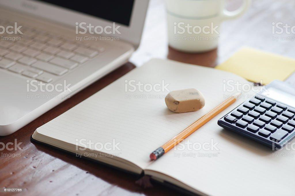 Desk, computer, pencil, notebook, erase, calculator, coffee cup stock photo