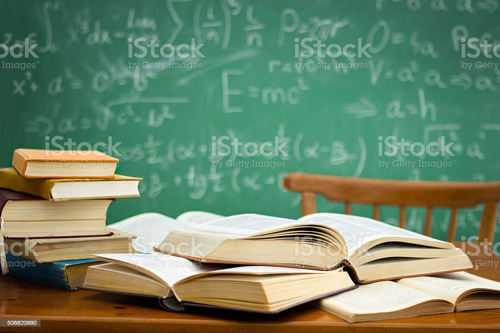 desk in a mess during learning stock photo