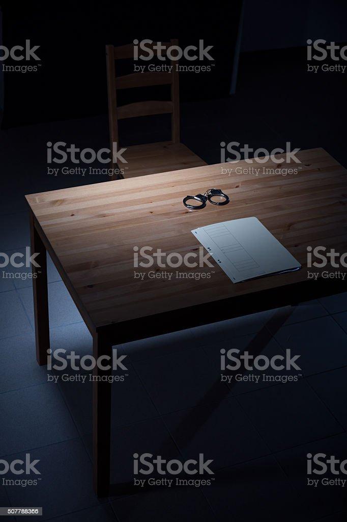 Desk in interrogation room stock photo