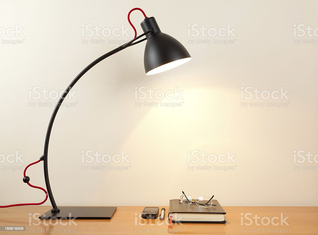 Desk lamp with notebook royalty-free stock photo