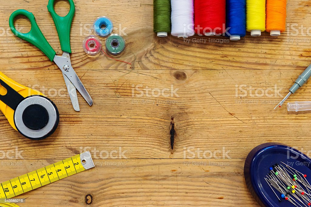 Desk of a tailor with various objects, flat lay stock photo