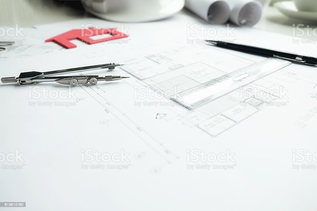 Desk of Engineering project in construction site or office with...