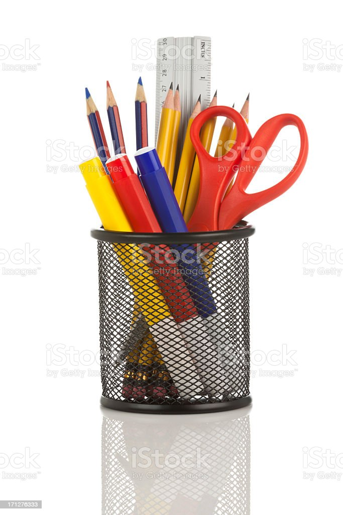 Desk organizer filled with some school supplies on white backdrop stock photo