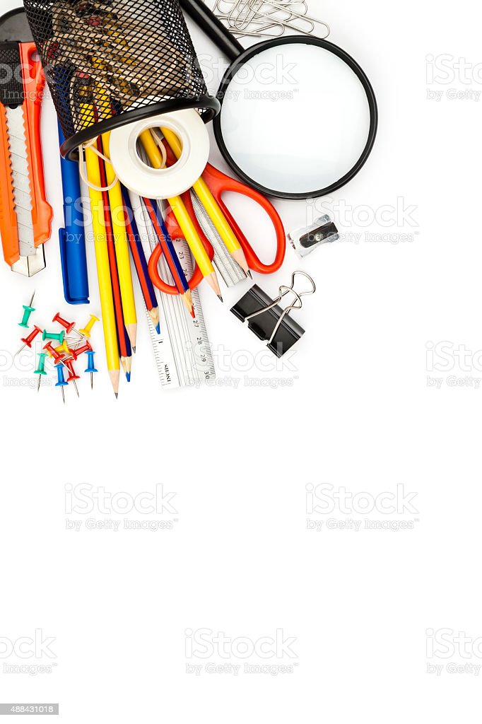 Desk organizer laying on white with office or school supplies stock photo