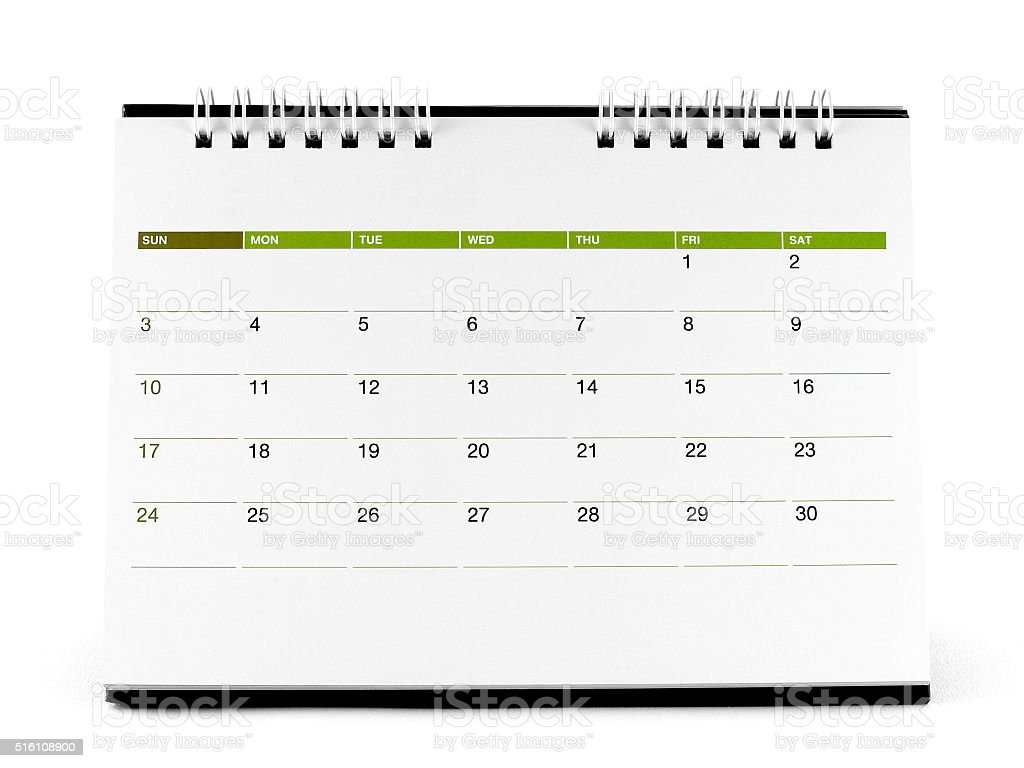 desk spiral calendar with days and dates in April 2016 stock photo