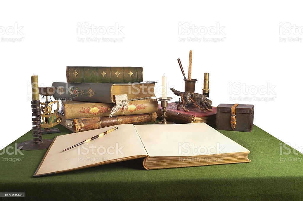 Desk with an open book and old stationery. royalty-free stock photo