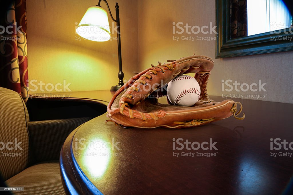 Desk with basball mitt stock photo