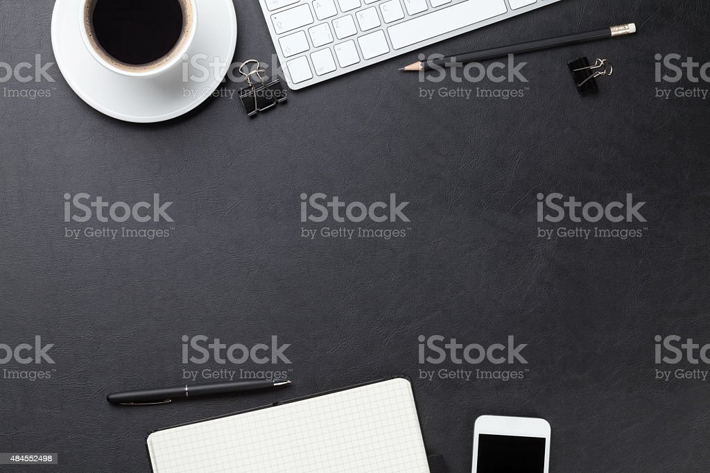 Desk with computer, supplies and coffee stock photo