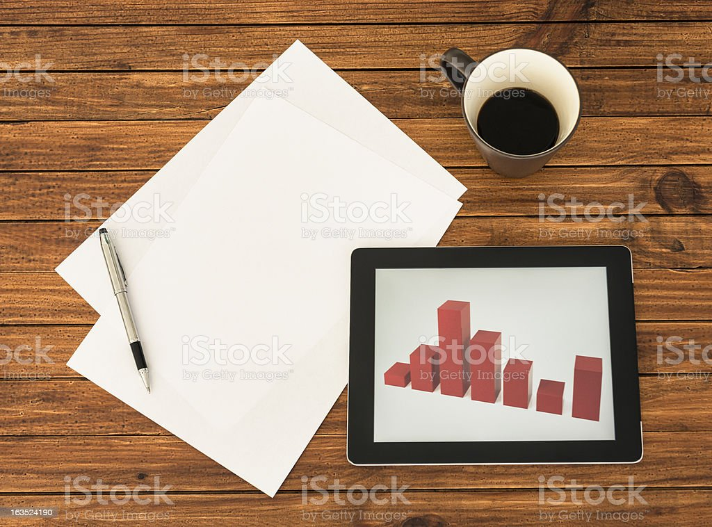 Desk with financial graph on digital tablet stock photo