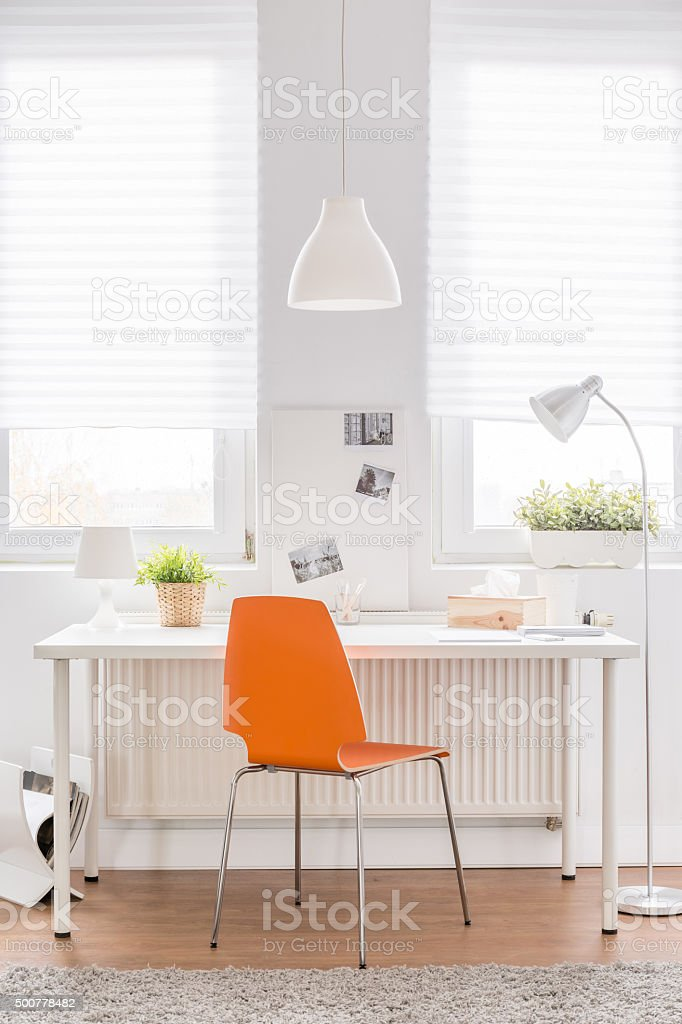Desk with orange chair stock photo
