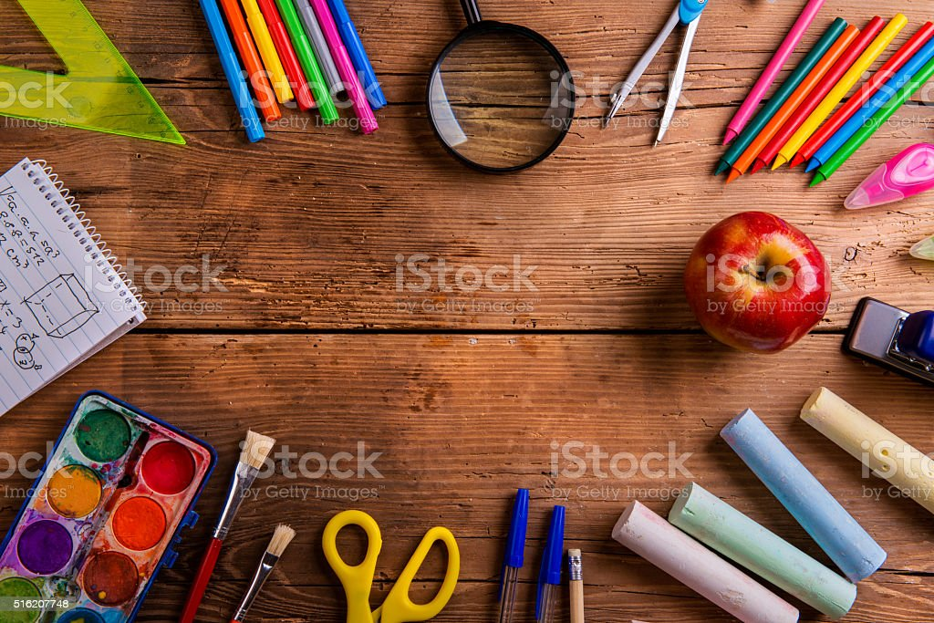 Desk with school supplies against wooden background, copy space stock photo