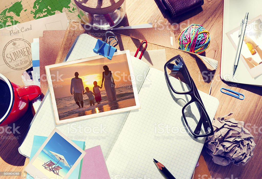Desk with Summer Photographs and Notebook stock photo