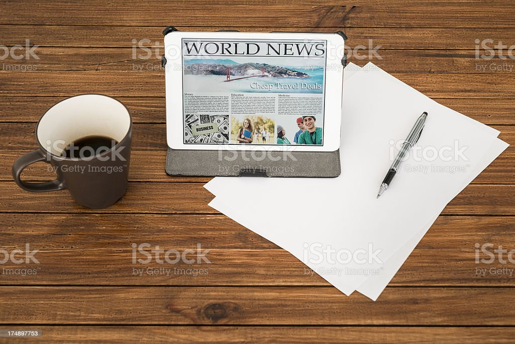 Desk with World news on digital tablet - san francisco royalty-free stock photo