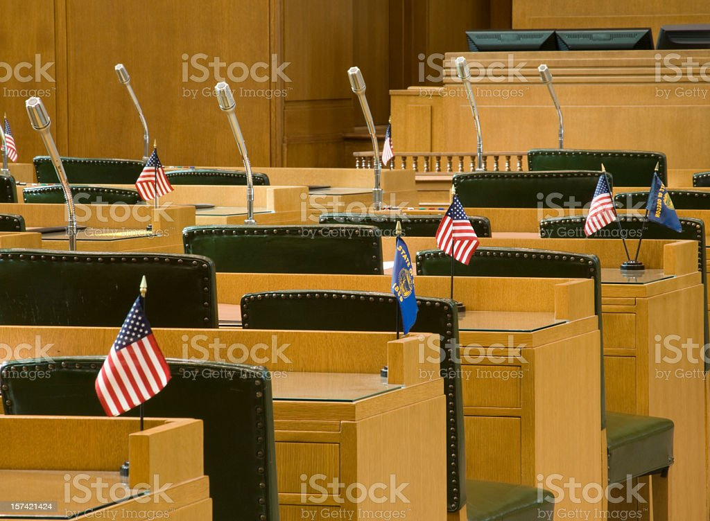 Desks with Flags and Microphones for Oregon House of Representatives stock photo