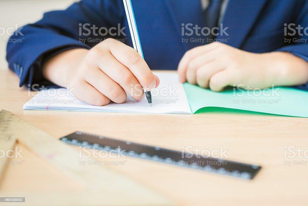 Desktop background of student sitting at desk for classwork stock photo