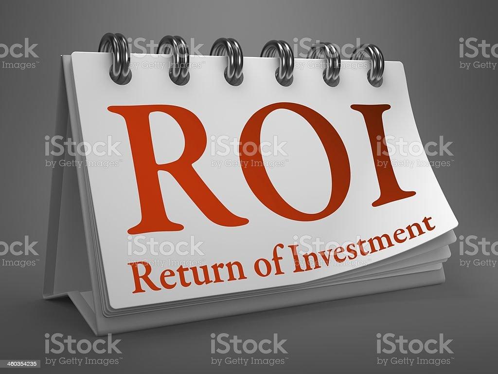 Desktop Calendar with ROI Concept. stock photo