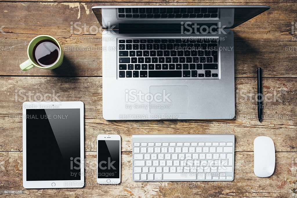 Desktop Essentials On Wooden Table stock photo