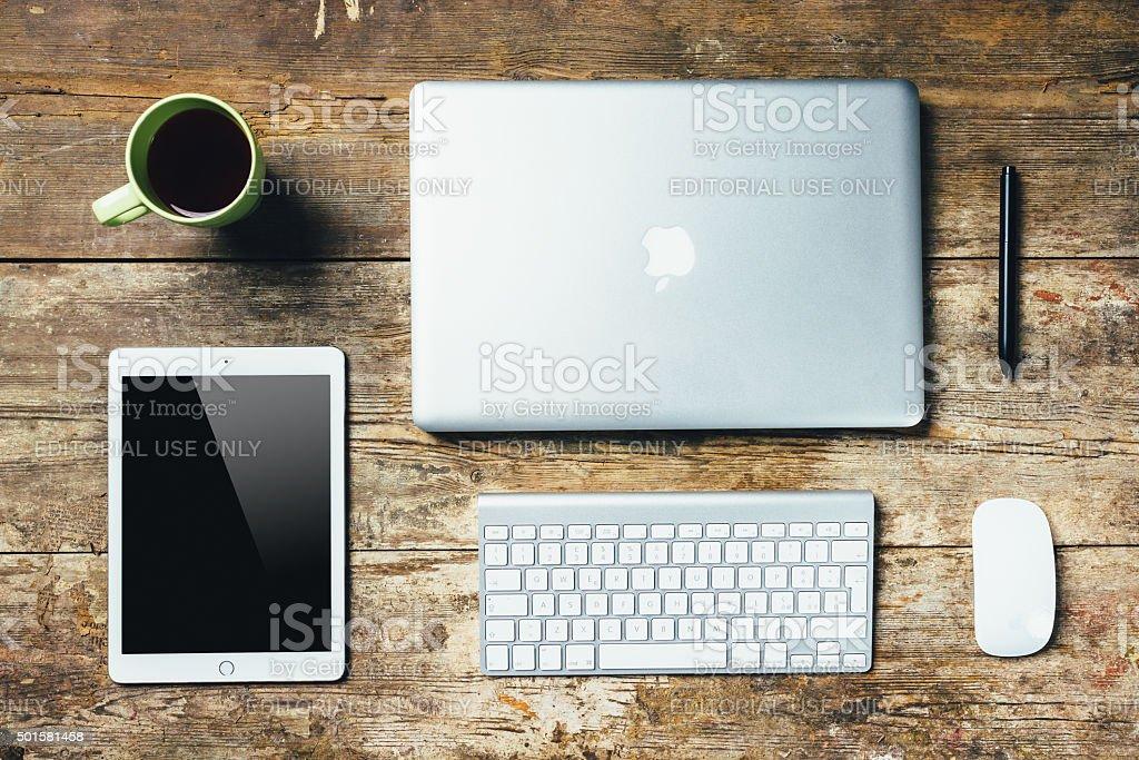 Desktop Essentials On Wooden Table stock photo