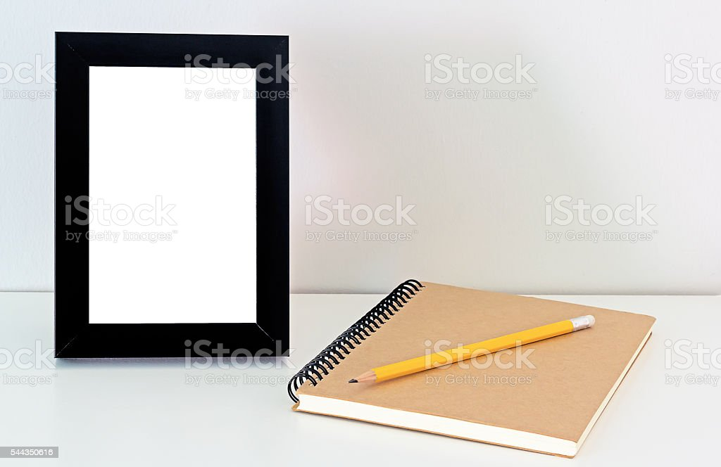 Desktop Frame and Notebook stock photo