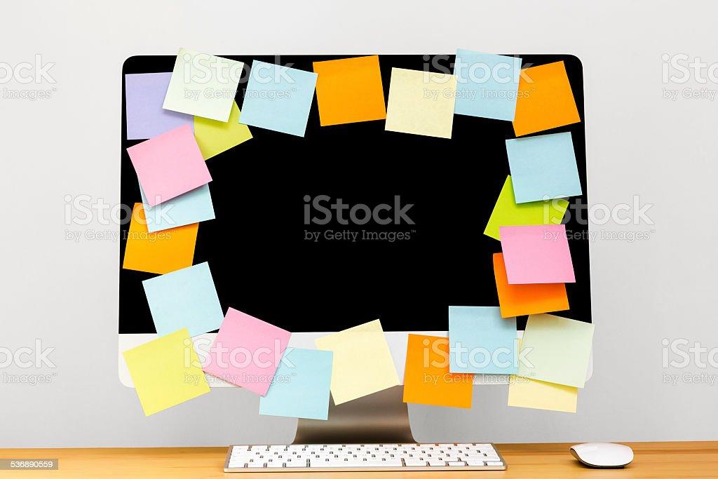 Desktop Full of Post it stock photo