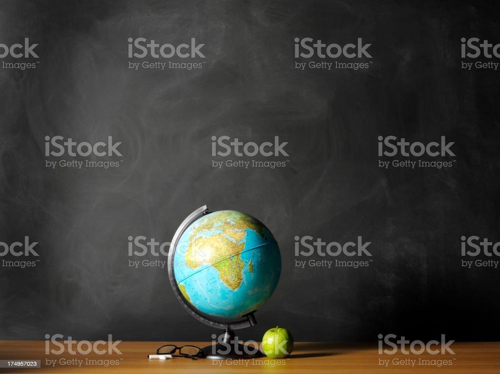 Desktop Globe with a Apple and Blackboard stock photo