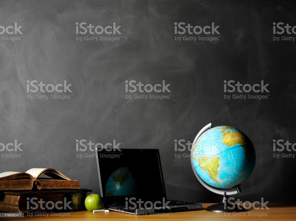 Desktop Globe with a Laptop Computer in the Classroom stock photo