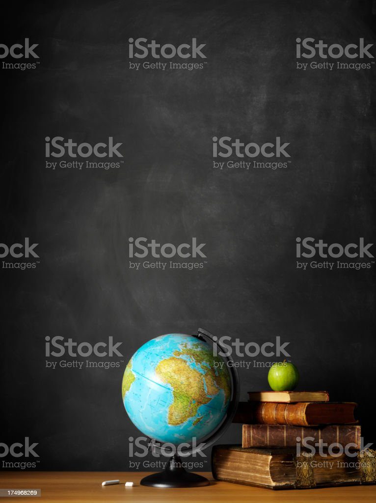 Desktop Globe with a Stack of Antique Books stock photo