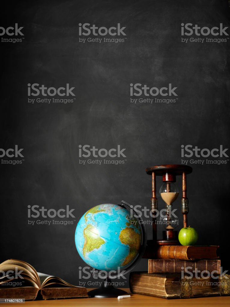 Desktop Globe with Books and a Hourglass stock photo