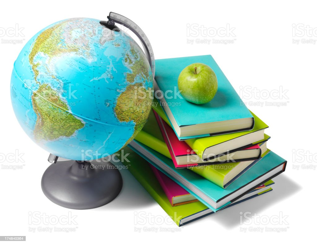 Desktop Globe with Coloured Books and Apple stock photo