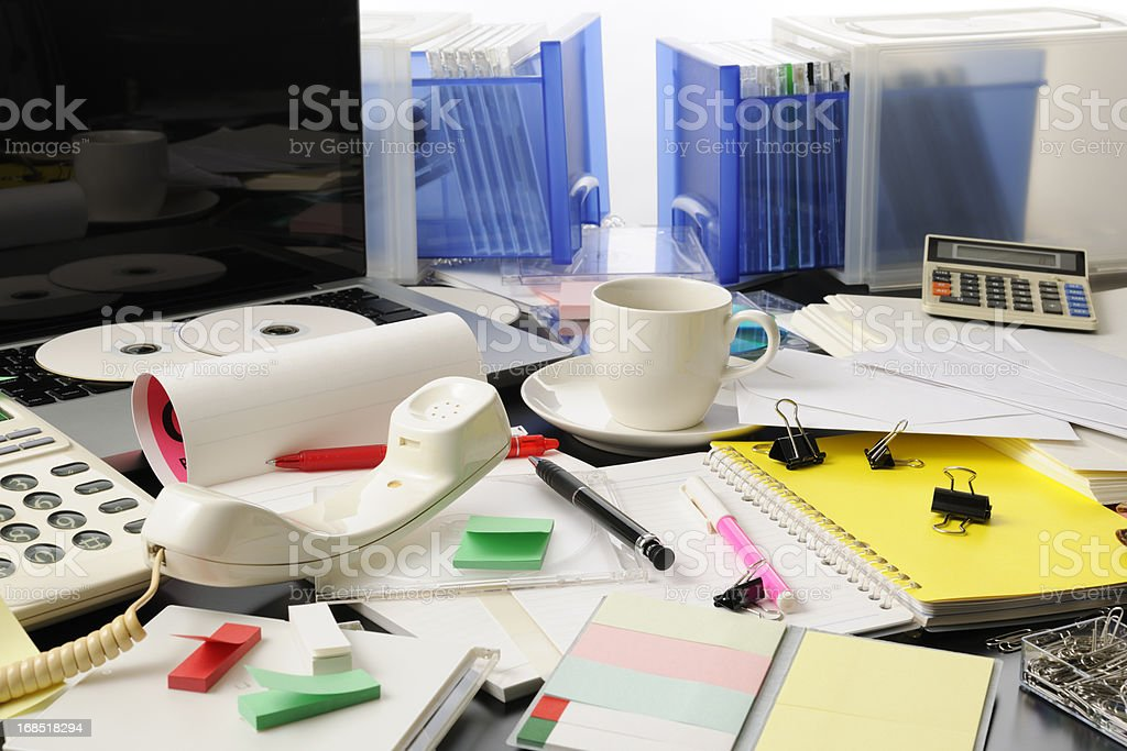 Desktop in a mess intensely stock photo