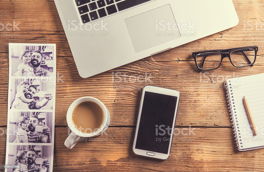 Desktop mix on a wooden office table. stock photo