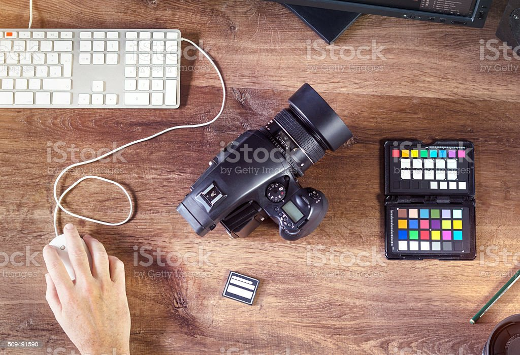 Desktop shot of a modern Digital Photo Camera with Laptop stock photo