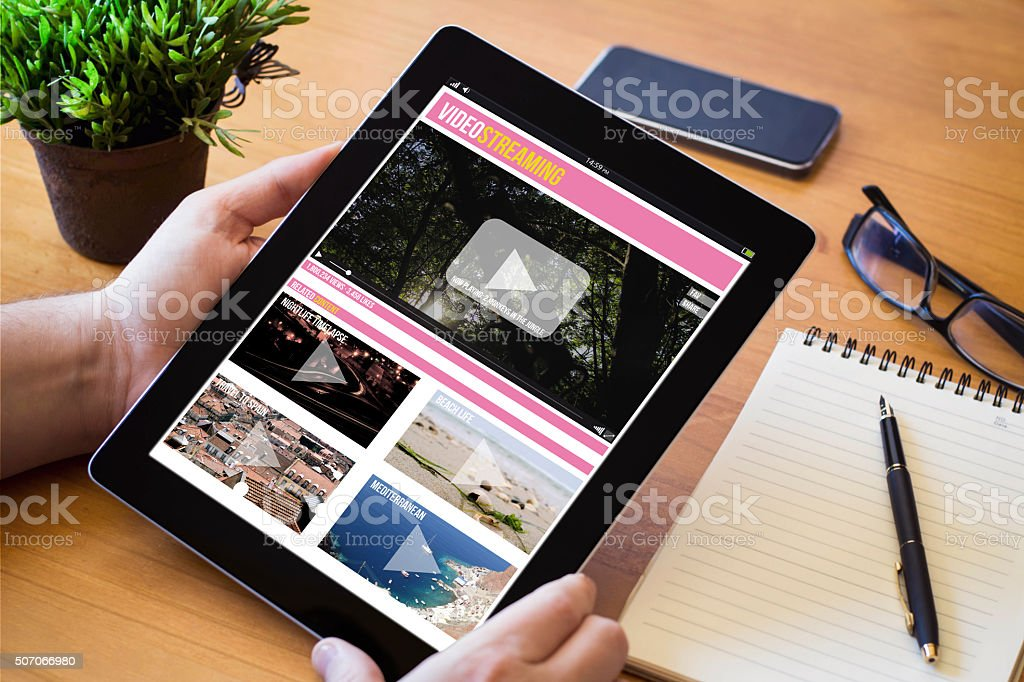 desktop tablet video streaming stock photo