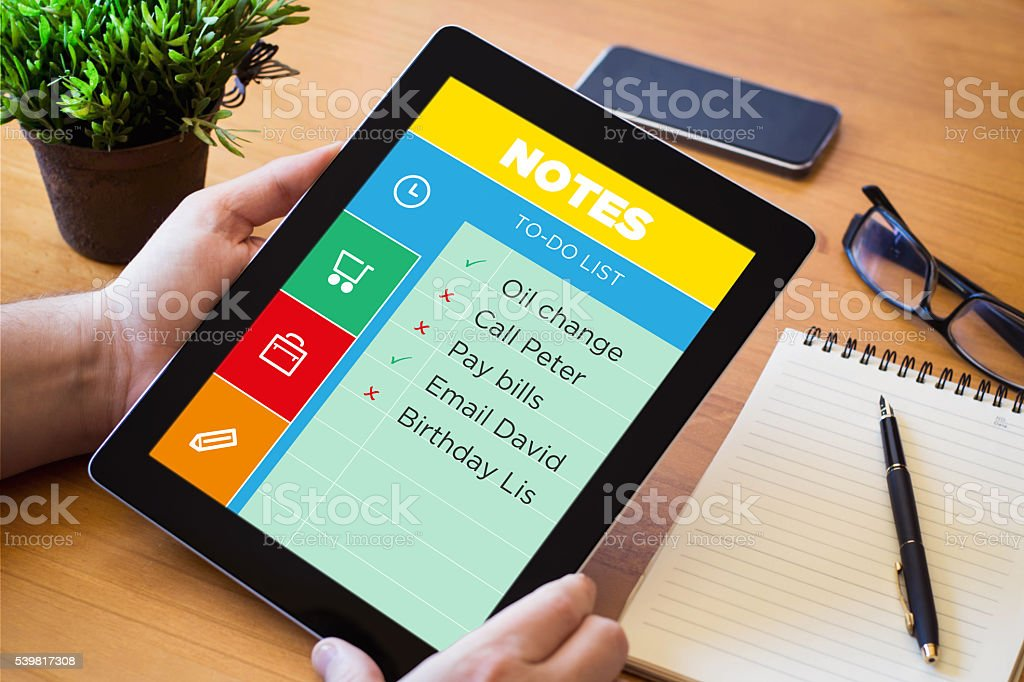 desktop tablet with note application stock photo